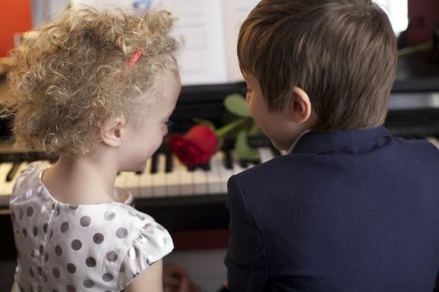 5 TWO CHILDREN AT THE PIANO WITH A ROSE.jpg