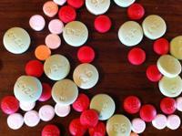 white_green_red_and_orange_pills.jpg.jpe
