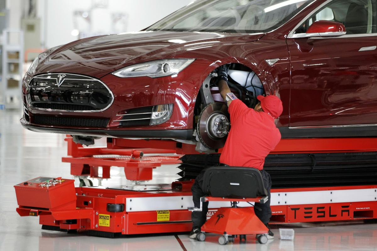 Charge Time: Electric Car Workers Accuse Tesla of Low Pay ...